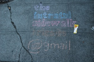 Transient sidewalk art, along with grime and litter