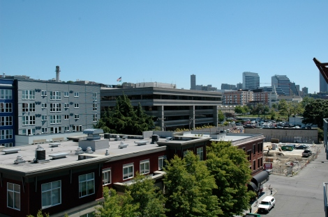 When we arrived in June, the space in the lower right hand corner of this view from our apartment window was vacant.