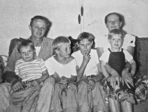 The family, approximately 1950. Dad and mom in back, with (L-R) Butch, Tom, Jim, and me.